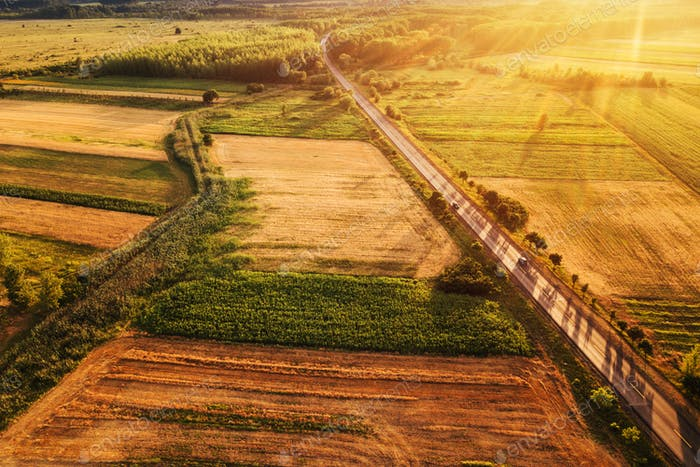 Beautiful aerial view of countryside and fields in sunset
