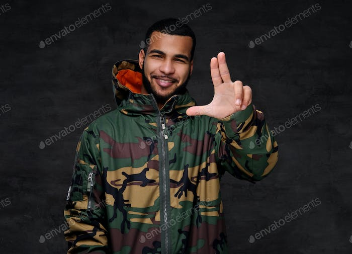 Handsome African-American guy wear military jacket.