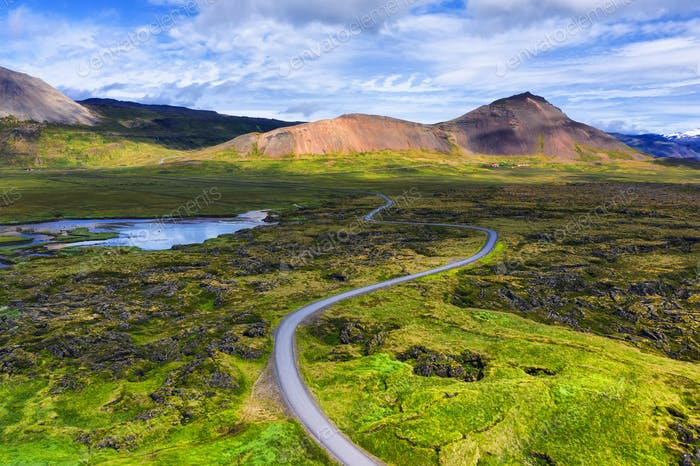 Aerial view on road in Iceland. Aerial landscape above highway in the geysers valley.