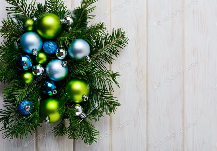 Christmas background with green, blue and silver ornaments