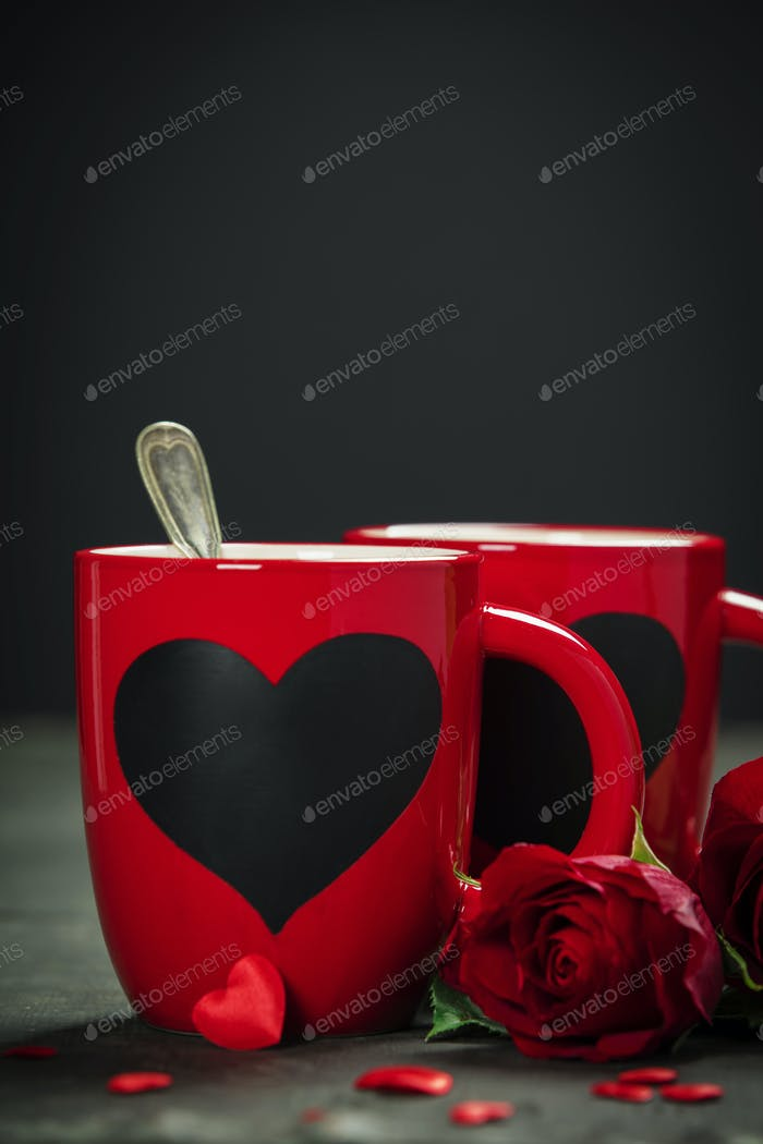 Valentine's Day concept. Red Cups and roses on a Wooden Background