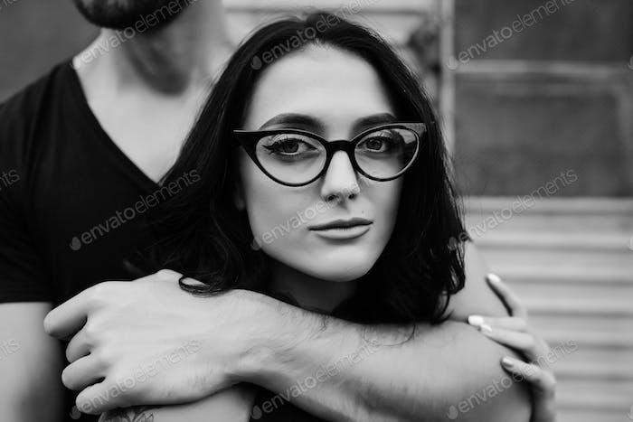 guy hugging his girlfriend from behind