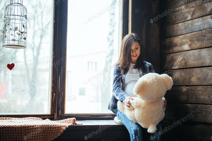 pregnant woman with soft bear