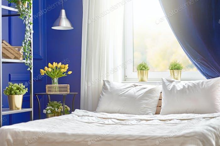 Bedroom in navy colors.