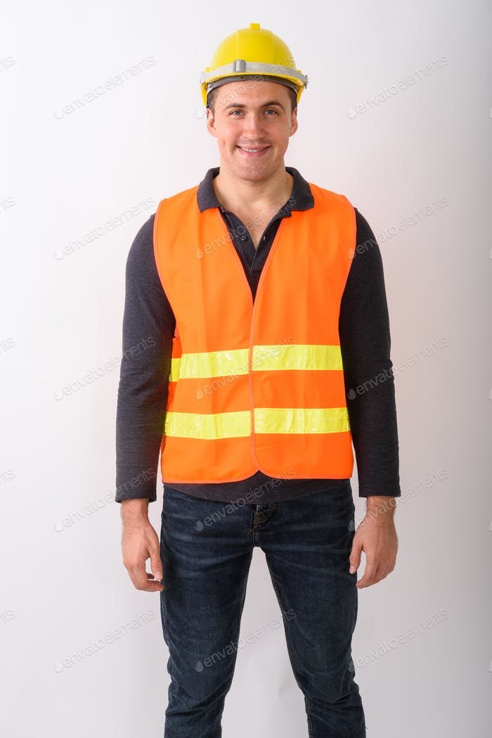 Portrait of young man construction worker standing