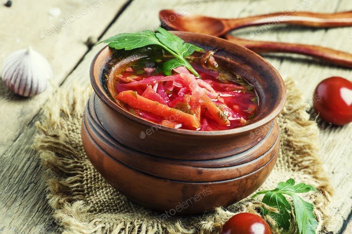 Russian soup borscht with cabbage, beetroot and tomatoes