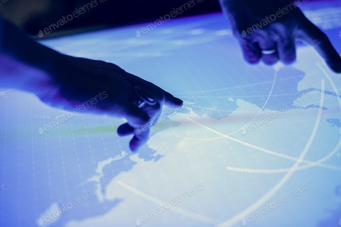 Hands point on a cyber space table