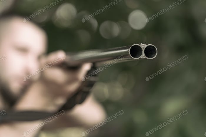 Man aiming a rifle