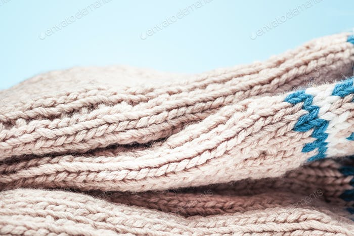 large folds on the warm knit light scarf