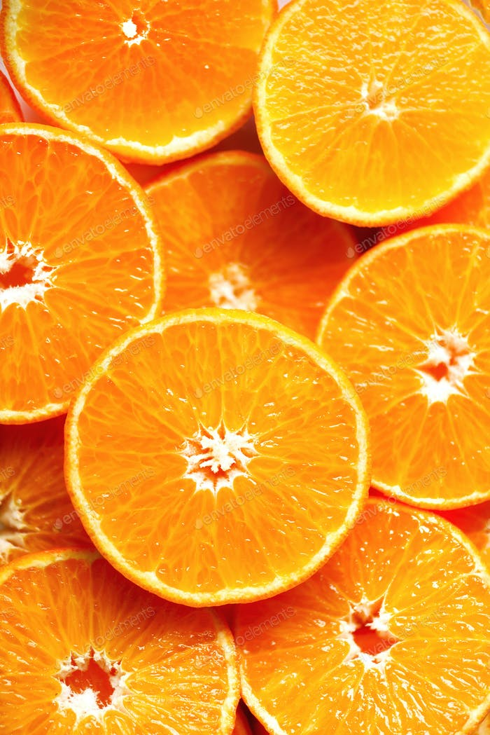 Fresh sliced orange fruit texture. Macro, top view, copy space. Food frame. Juicy oranges background