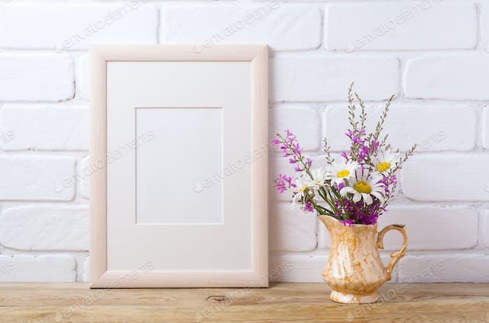 Wooden frame mockup with chamomile and purple flowers in golden