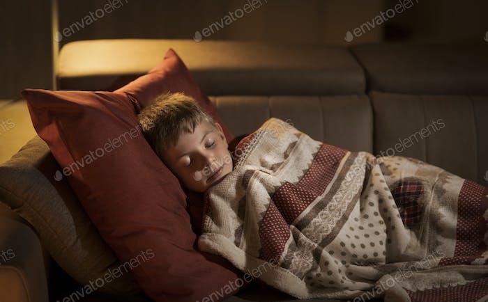 Cute boy sleeping on the sofa