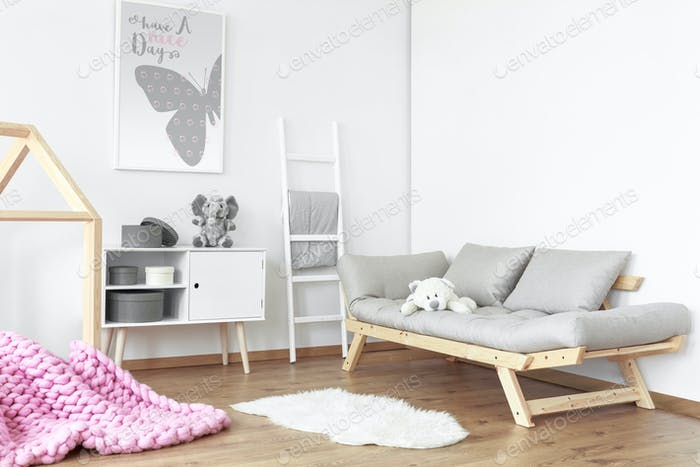 Grey sofa with teddy bear