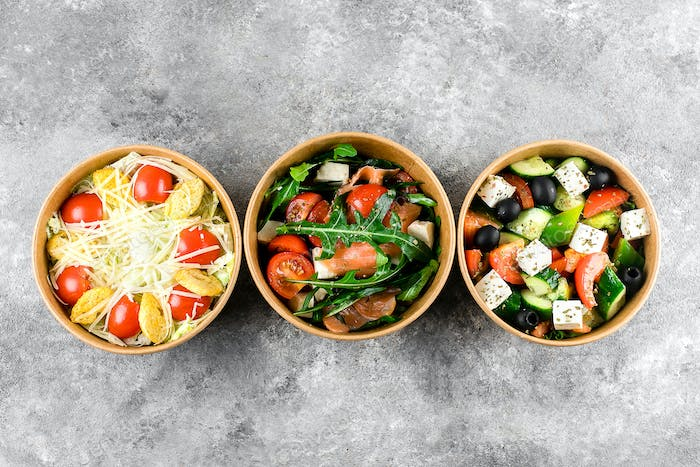 Healthy food delivery, Food Takeout. Vegetable salads in zero waste containers. Top view, flat lay