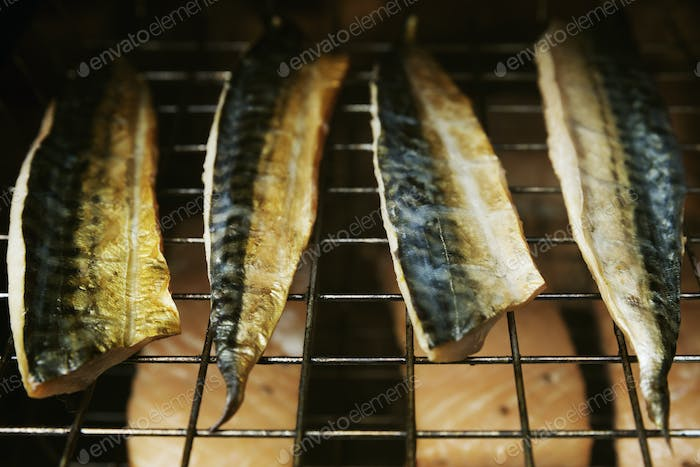 Close up of Mackerel fillets on a rack in a fish smoker.