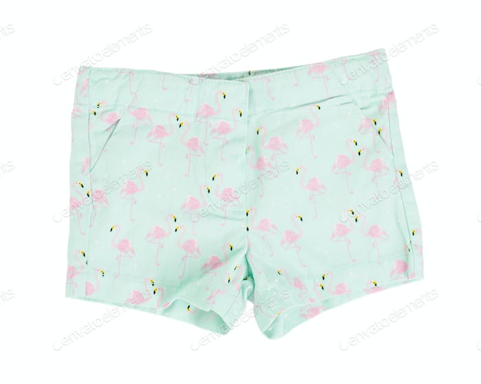 Green shorts with flamingo pattern.