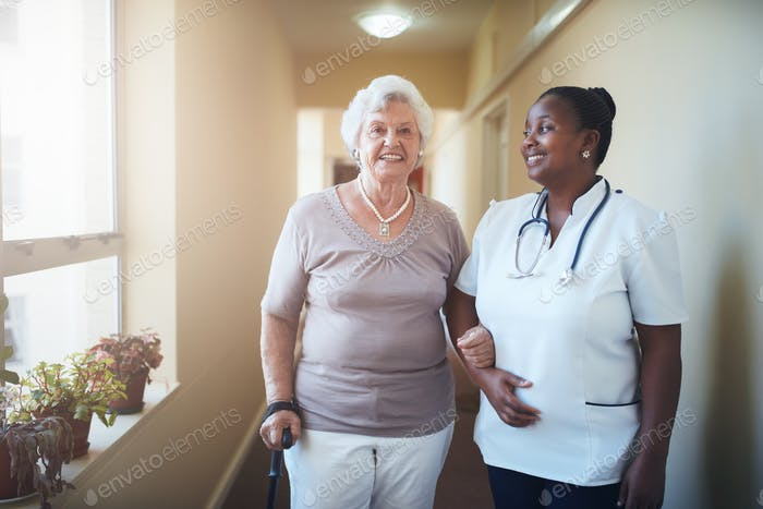 Happy doctor and patient together at nursing home