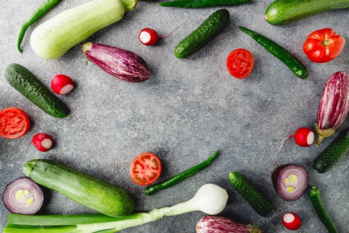 Colorful summer pattern with different fresh vegetables on a grey background