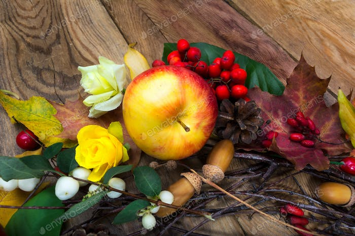 Thanksgiving background with apple and yellow roses