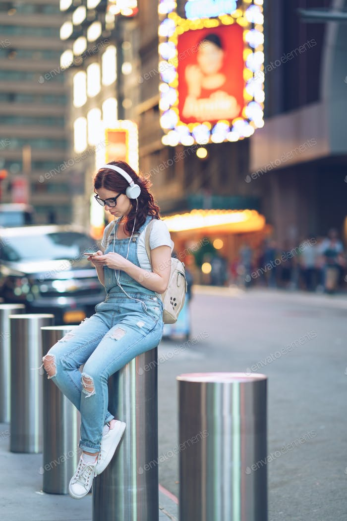 Young girl with headphones outdoors
