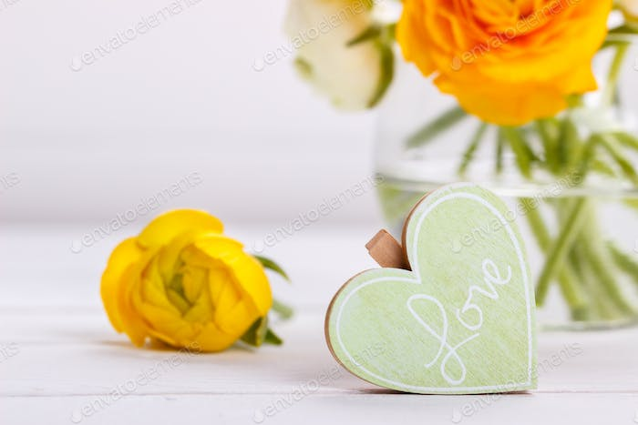 Wooden heart and flowers
