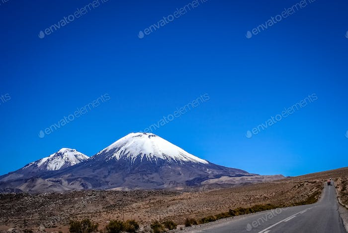 Road and Volcanoes in Park Lauca