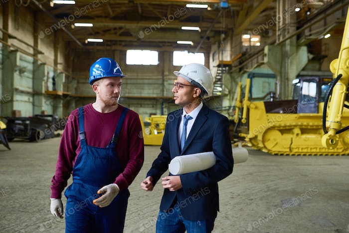 Discussing Project with Factory Worker