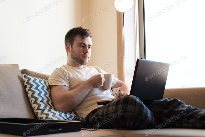 Man with laptop at living room