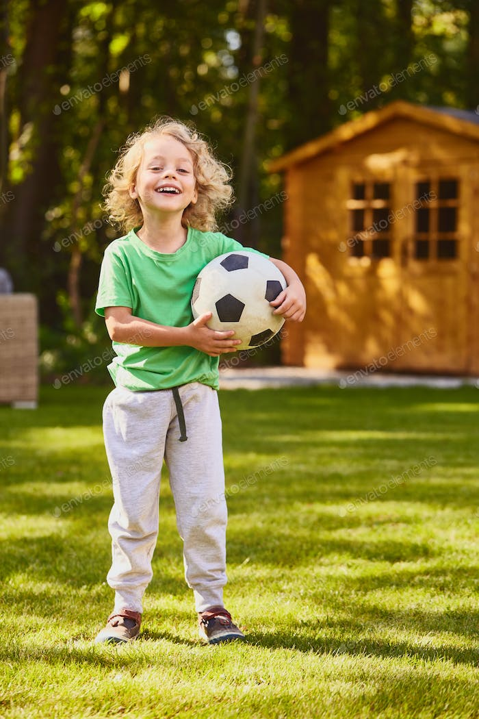 Son standing with a ball