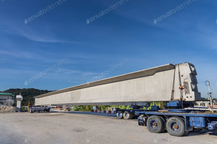 Truck transport pre-fabricated concrete beam to construct light rail transit infrastructure