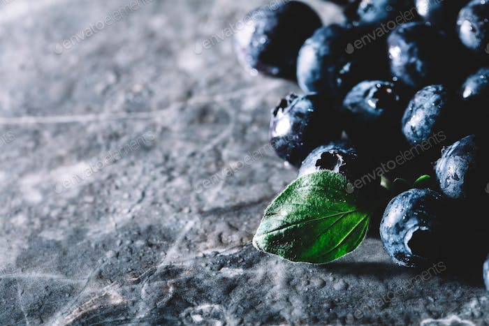 Fresh juicy blueberries and a green leaf