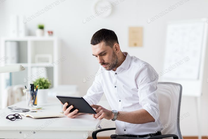 businessman with tablet pc at office