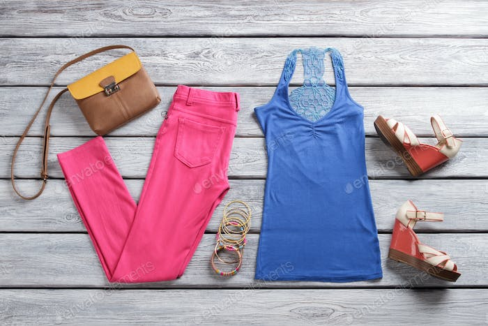 Blue top and pink pants.