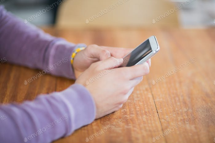 Cropped hands of person holding mobile phones