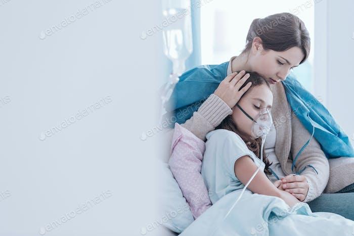 Girl using an oxygen mask
