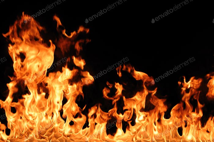 Abstract fire burns on dark background