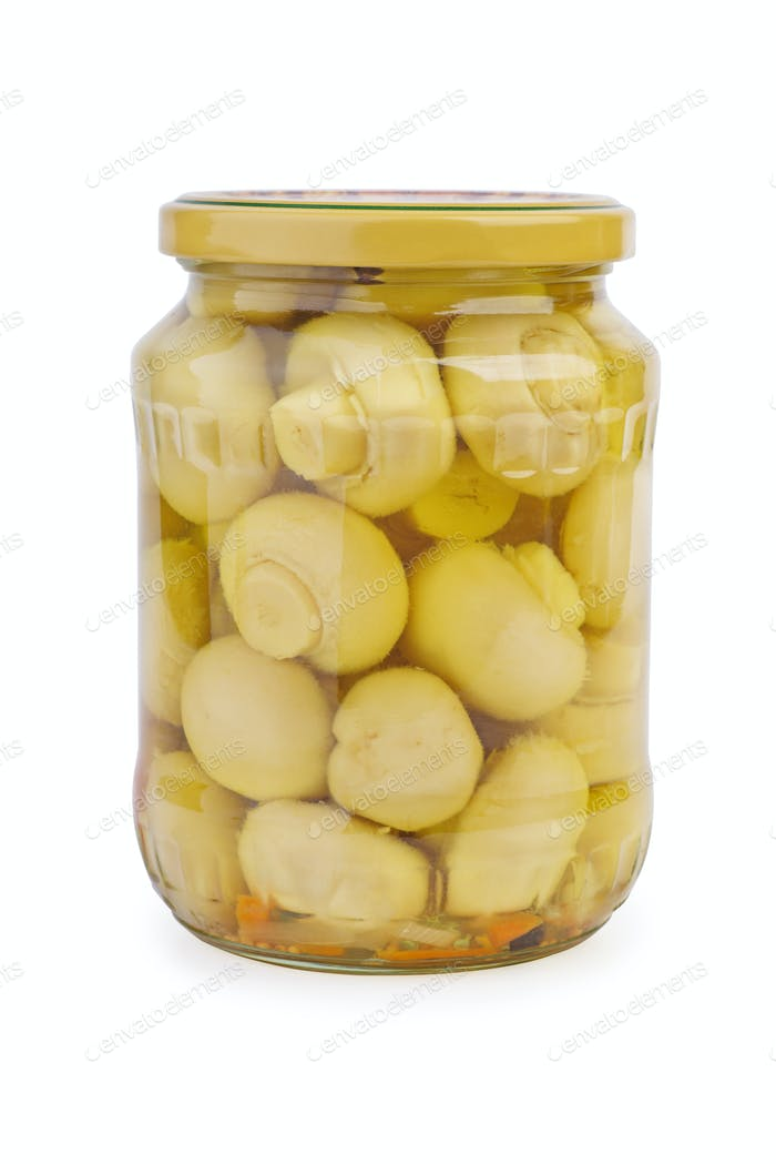 Glass jar with marinated white button mushrooms