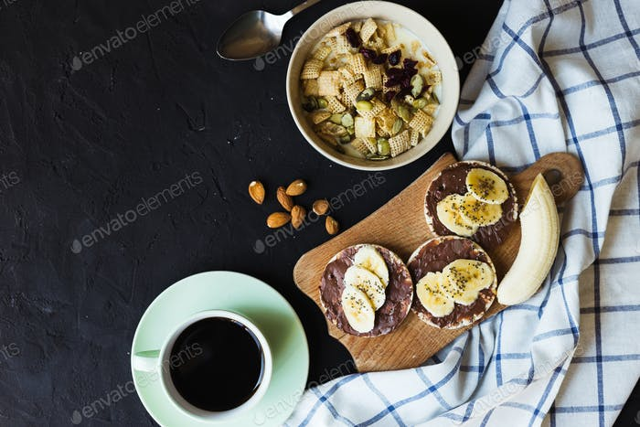 Healthy breakfast. Fresh granola, muesli with milk berries nuts. View from above.