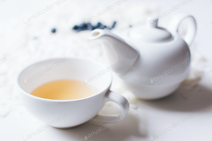 Pearly white porcelain teapot and cup