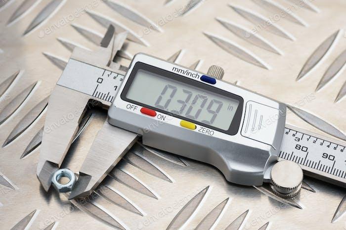 Metal digital calliper on anti slip aluminum metal plate