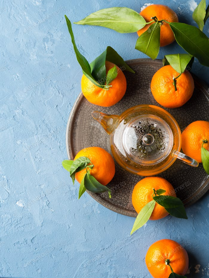 Tangerines and green tea still life