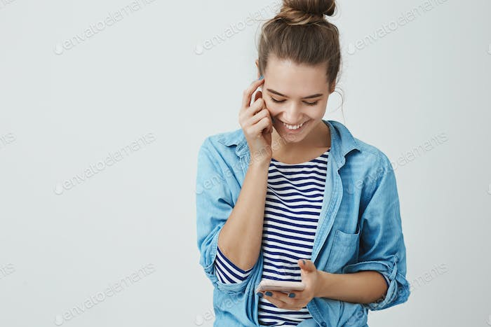 Girl laughing smiling happily reading silly cute message boyfriend, typing answer pressing