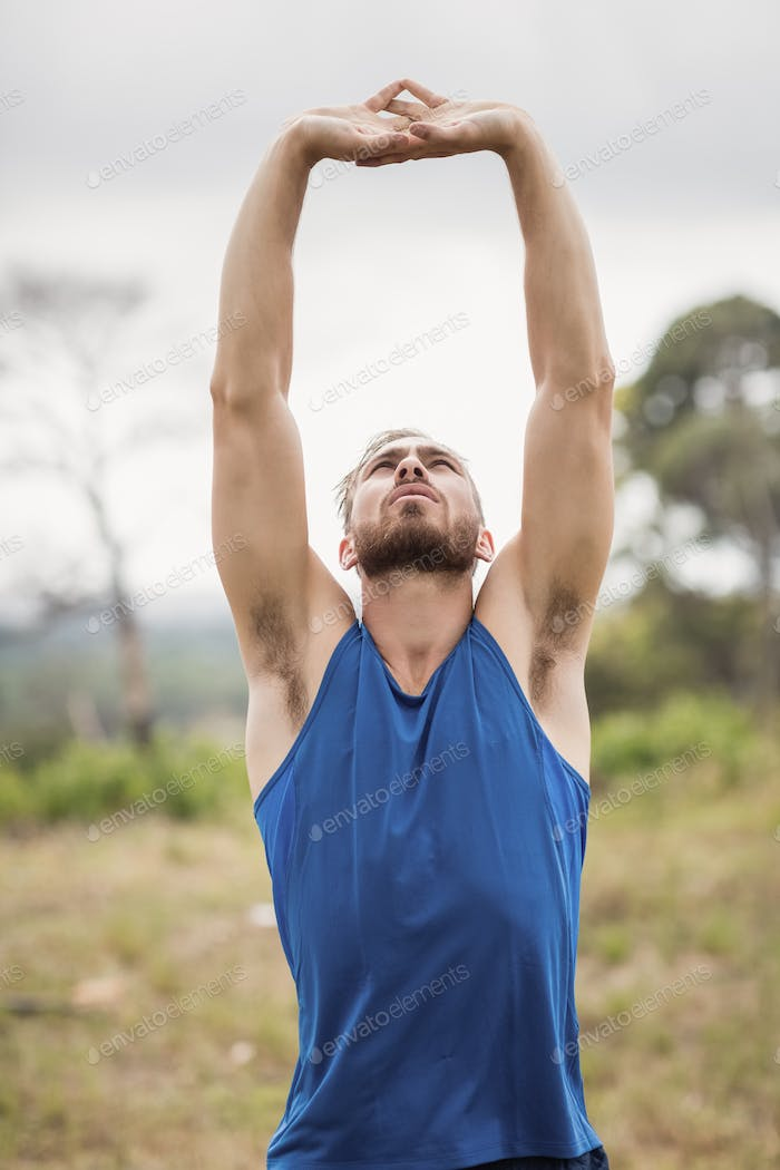 Fit man performing stretching exercise
