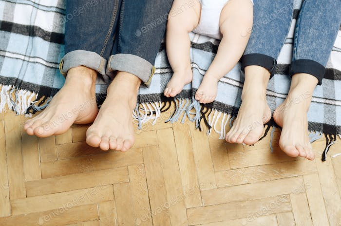 Feet of Young family on the floor