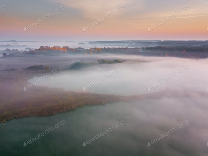 Beautiful misty dawn. Flying above the clouds, aerial view