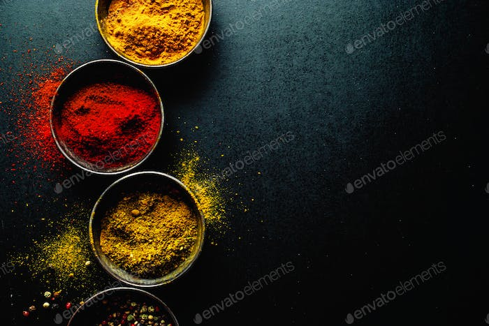 Colorful spices on dark background