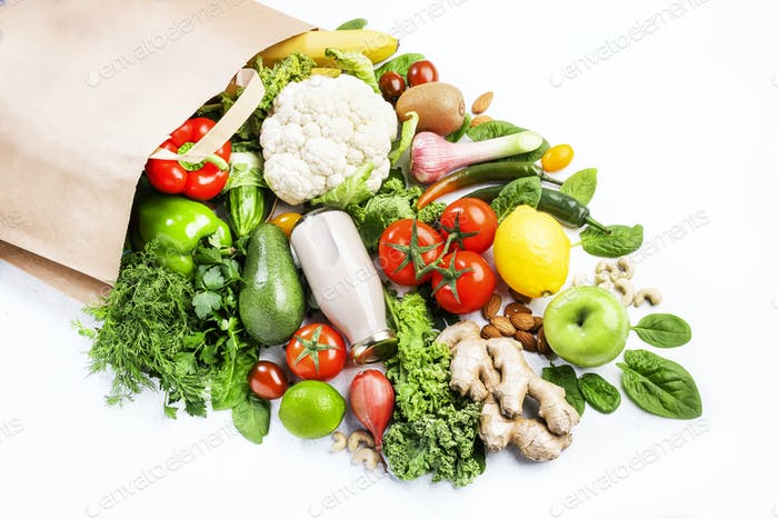 Healthy vegan vegetarian food in full paper bag, vegetables and fruits