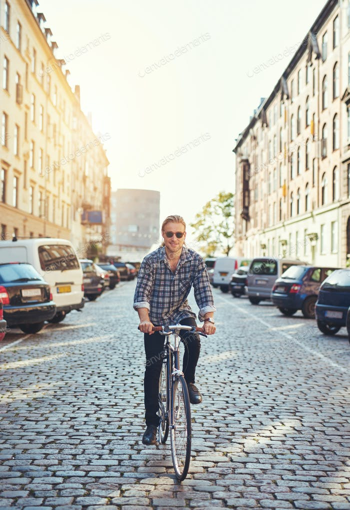 Man riding his bike through the city