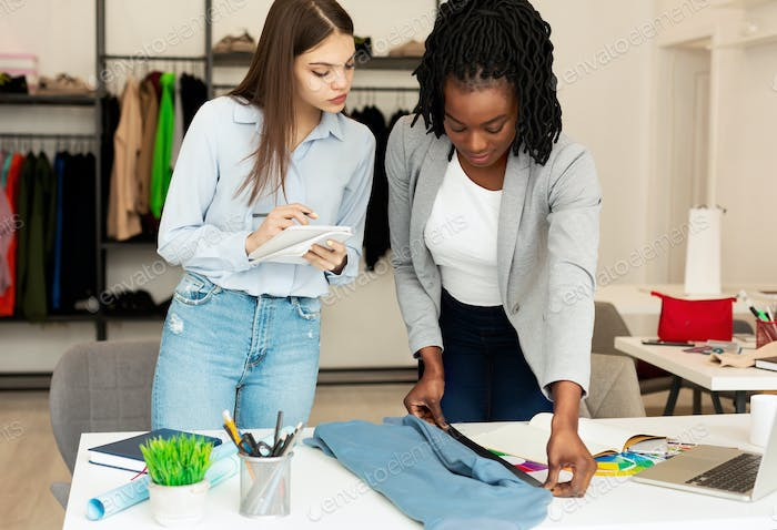 Diverse Designers Working On Clothing Line In Atelier