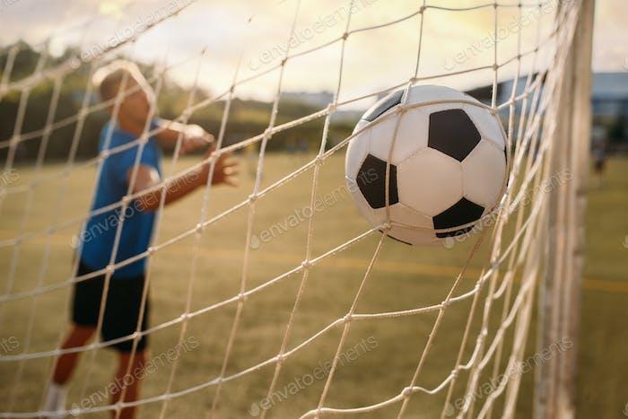 Male soccer goalkeeper missed the ball